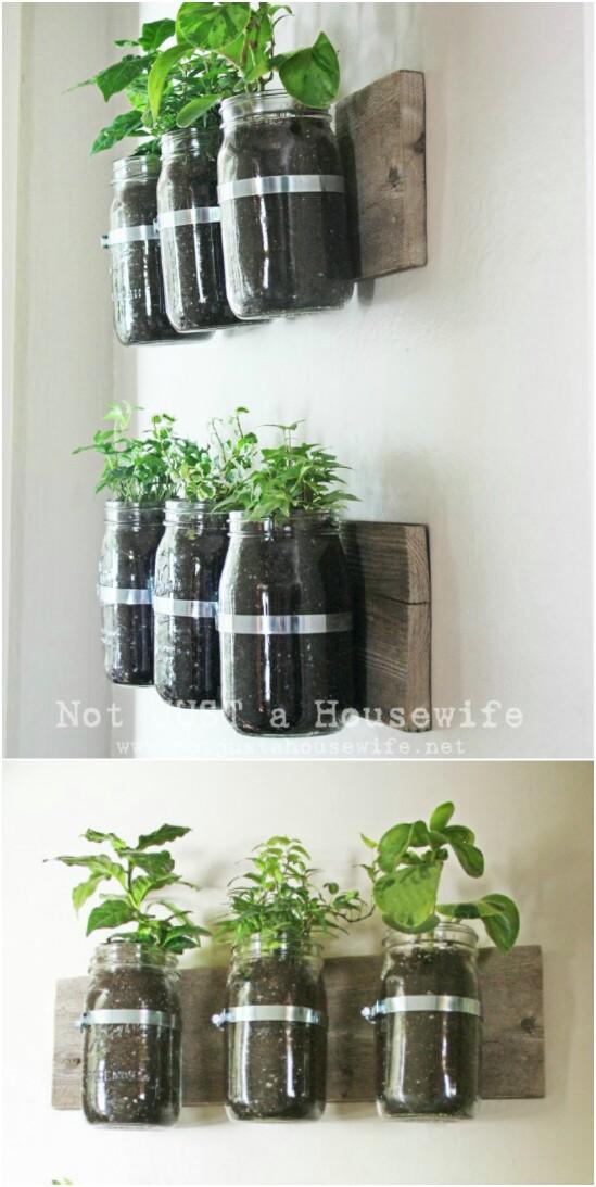 14 herb garden vertical 15 Amazing DIY Mason Jar Organizers You'll Want To Make Right Away