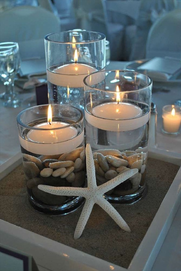 A beachy candle with river rocks in glass